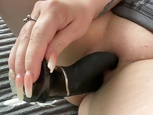 Wife satisfying her kinky wet pussy with toy